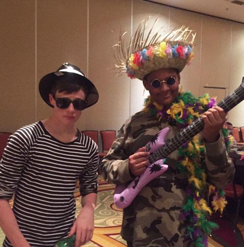 Photo of two young men with fun costumes at a karaoke party