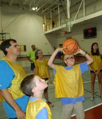 Photo of three people playing basketball