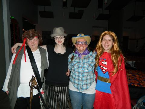 Photo of people wearing Halloween costumes