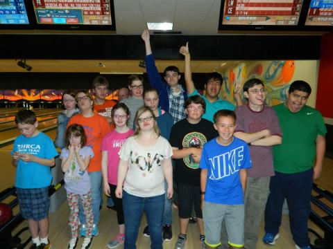 Photo of young people at bowling alley