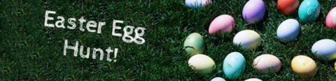 colored eggs in green grass with the words Easter Egg Hunt