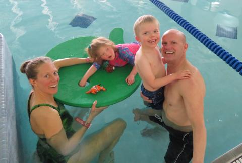 Photo of a family in a swimming pool