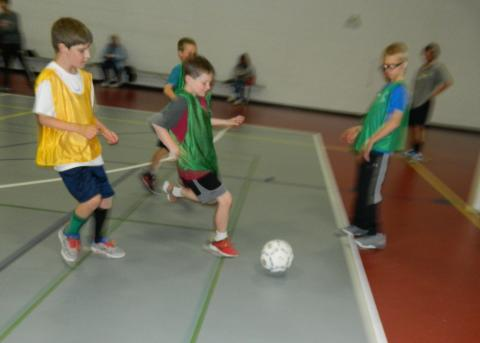 Photo of boys playing soccer