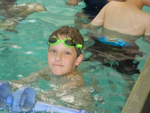 Photo of boy swimming in the pool
