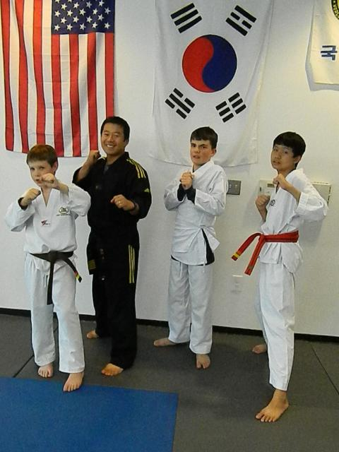 Photo of four Tae Kwon Do students
