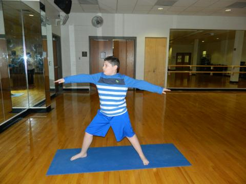 Photo of young person doing yoga