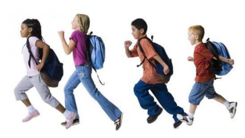 Photo of happy students, running to the left with backpacks!
