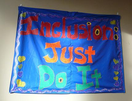 """Photo of a sign that reads """"Inclusion: Just Do It"""""""