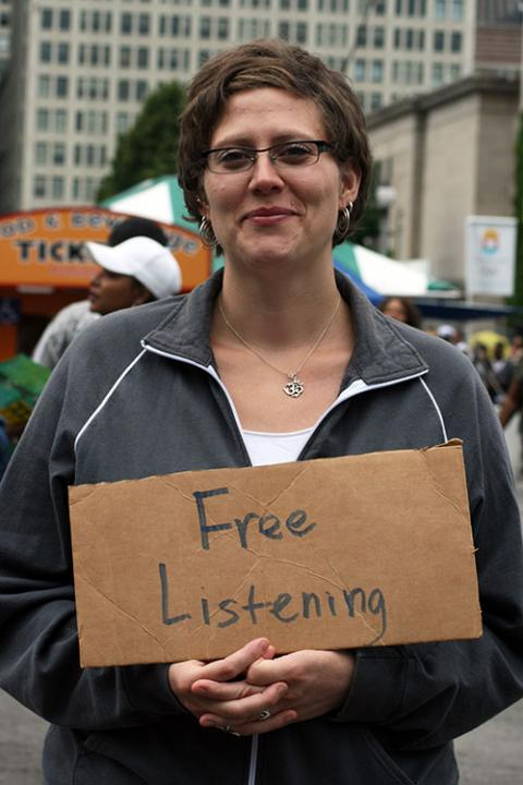 Photo of Woman Holding Sign Saying Free Listening