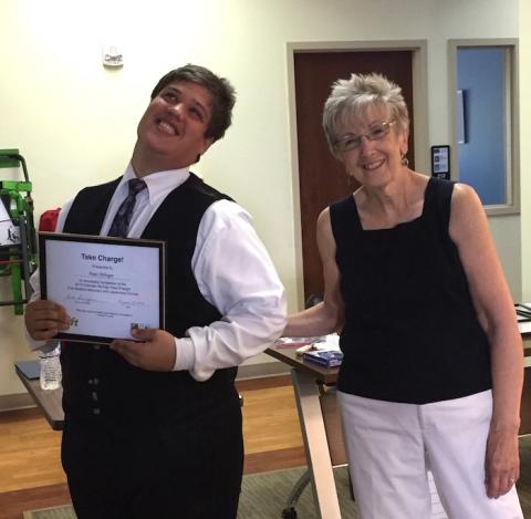 Photo of Ryan graduating from Take Charge and Coordinator Beth Schaffner from PEAK