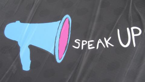 Graphic of a megaphone that says Speak Up