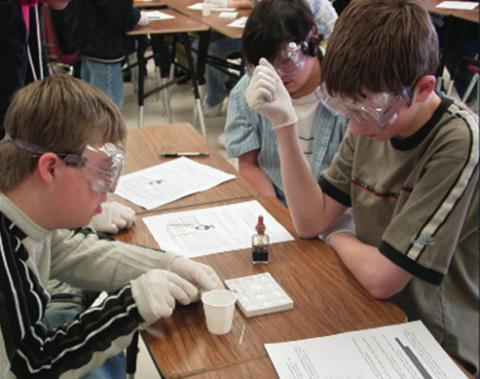 Photo of an inclusive science class, where students are working on an experiment.