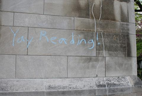"Photo of a brick wall that has ""Yay Reading!"" written on it in chalk!"