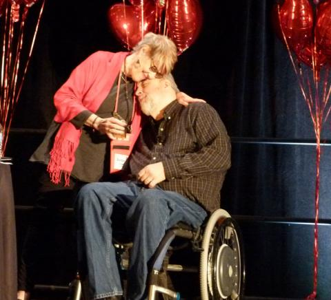 Photo of Dan Wilkins receiving his Ally for Inclusion Award with Barbara Buswell