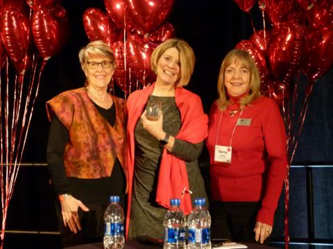 Photo of Paula Kluth holding her Ally for Inclusion Award with Barb Buswell and Gerry Olvey