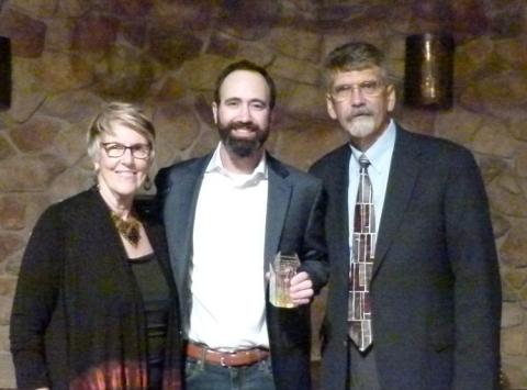 Photo of Scott Kupferman holding his Ally for Inclusion Award with Barb Buswell and Dave Meeks
