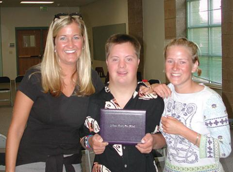 Photo of a self-advocate with his high school diploma.