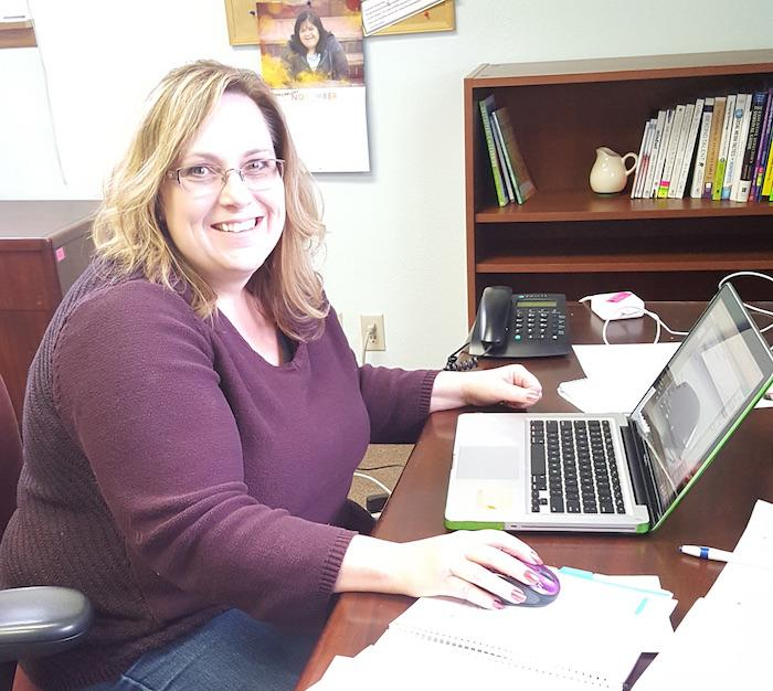 Photo of PEAK Parent Advisor Cindy Colwell working at her computer