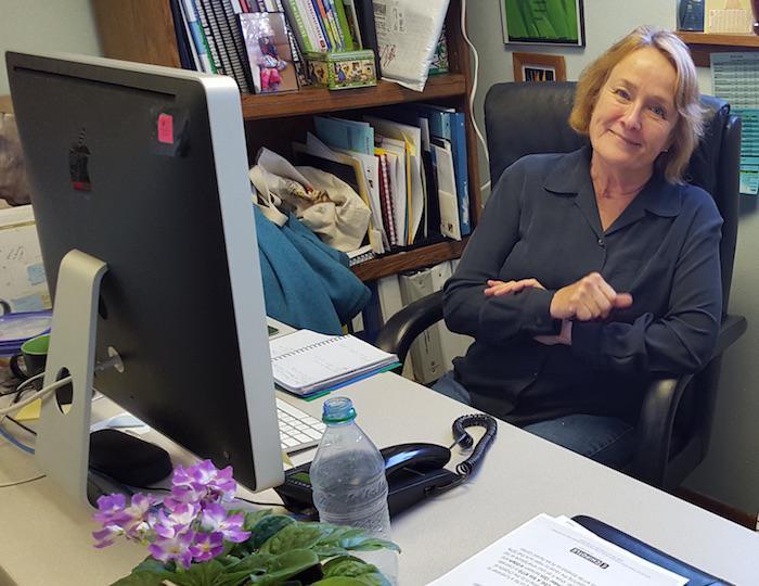 Photo of PEAK Parent Advisor Shirley Swope working at her desk