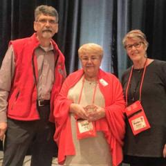 Photo of Diana Jolly holding her Ally for Inclusion Award with Barb Buswell and Dave Meeks