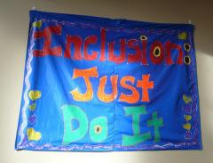 "Photo of a sign that reads ""Inclusion: Just Do It"""