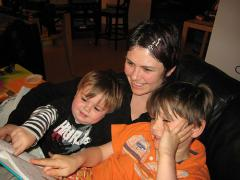 Photo of mom reading with children included