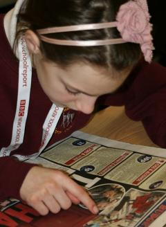 Photo of student reading the newspaper