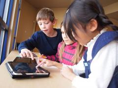 Photo of Students Working Collaboratively on an iPad