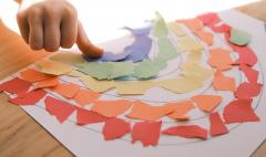 child making rainbow craft to promote diversity, awareness and inclusion