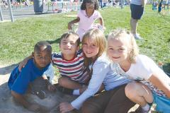 Photo of elementary students hanging out at track day!