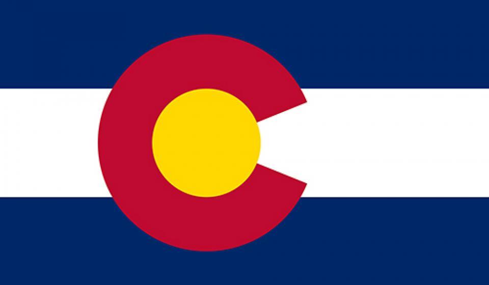 Image of Colorado's Flag with a Description of PEAK's Colorado Calendar Overlayed